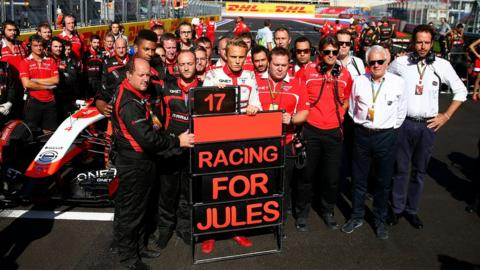 The Marussia team pay tribute to Jules Bianchi at the Russian GP