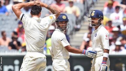 India batsmen Ajinkya Rahane (centre) and Virat Kohli (right) limited the impact of Australia pace bowler Mitchell Johnson
