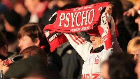 Fan holds a Stuart Pearce scarf up in support of the Nottingham Forest manager