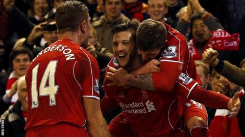 Liverpool players celebrate against Swansea