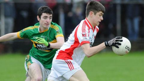 Watty Graham's Danny Tallon closes in on Southern Gaels opponent David Wilson during the Minor Club final tournament in Belfast