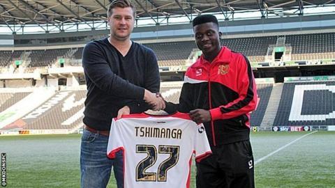 Karl Robinson (l) with Kabongo Tshimanga