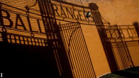 A shadow of the gates at Ibrox Stadium