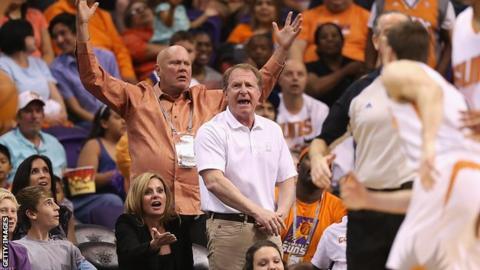 Robert Sarver shows his enthusiasm during a Phoenix Suns basketball game