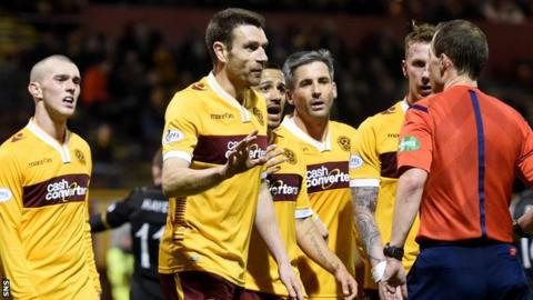 Motherwell players, including Stephen McManus, compain to referee Willie Collum