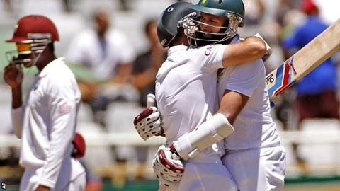 South African Dean Elgar, left, reacts with Hashim Amla
