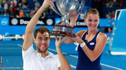 Poland team Jerzy Janowicz and Agnieszka Radwanska celebrate Hopman Cup win
