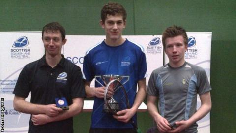 Rory Stewart poses with the Scottish Junior Squash Under-19 trophy
