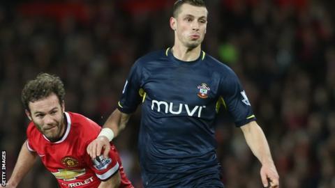 Morgan Schneiderlin of Southampton and Manchester United's Juan Mata