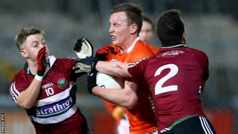 Armagh's Declan McKenna is challenged by St Mary's pair Jerome Johnston and Ruairi Wilson