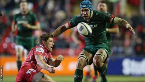 Rhys Priestland moves the ball away under pressure