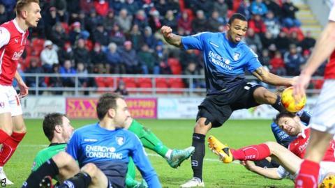 Callum Wilson hooks home Bournemouth's second goal against Rotherham