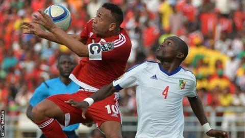 Equatorial Guinea's Emilio Nsue beats Congo's Boris Moubio Ngonga to the ball