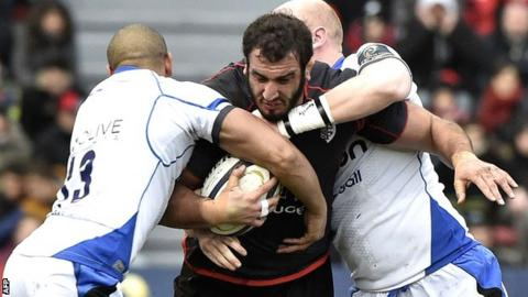 Toulouse second row Yoann Maestri is tackled by Bath centre Jonathan Joseph and flanker Matt Garvey