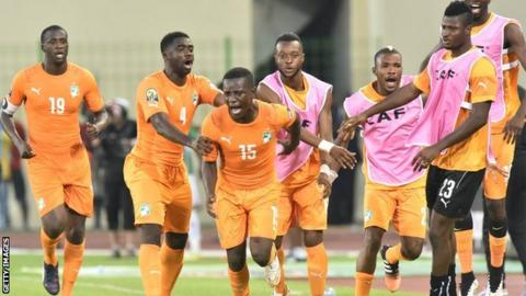 Max Gradel (centre) celebrates scoring Ivory Coast's equaliser