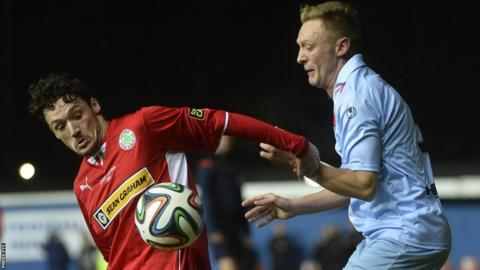 Cliftonville's Tomas Cosgrove in cup final action against Stephen McBride of Ballymena United