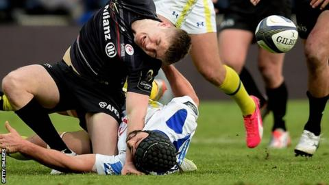 Owen Farrell is injured in a tackle by Clermont's Portugal flanker Julien Bardy