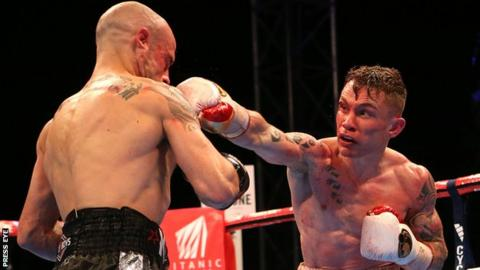 Kiko Martinez takes another punch from Carl Frampton in the world title fight in September