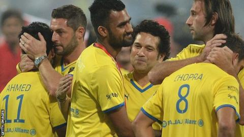 Jamie McAllister (second left) and Sachin Tendulkar commiserate Kerala's players after losing the Indian Super League final