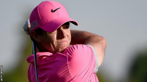 Rory McIlroy watches his second shot at the 18th on Friday