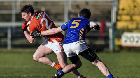 Armagh's Neil McDonald peels away from Seamus Kennedy of Tipperary as the Orchard County emerge 2-08 to 0-13 victors at the Athletic Grounds