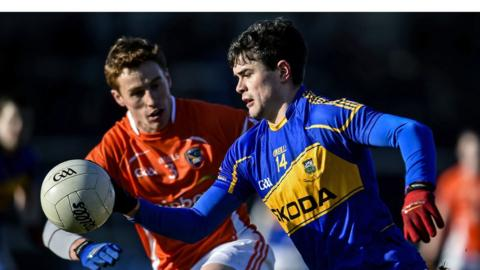 Charlie Vernon closes in on Michael Quinlivan during Armagh's Division Three win over Tipperary