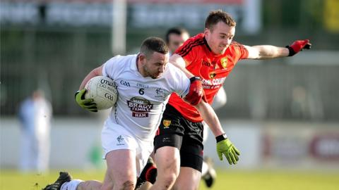 Kildare's Daryl O'Brien attempts to shrug off the attention of Brendan McArdle as Down win 3-13 to 1-15 in Division Two