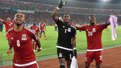 Equatorial Guinea players celebrate with fans after reaching the Nations Cup semi-final
