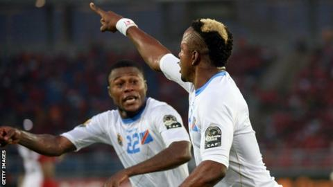 DR Congo's Joel Kimwaki celebrates after scoring against in their Nations Cup quarter-final