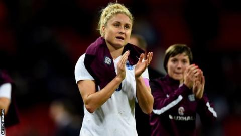 Steph Houghton (left) applauds fans at Wembley