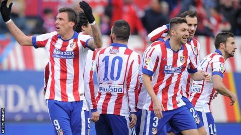 Mario Mandzukic and Atletico Madrid players celebrate their fourth goal against Real Madrid