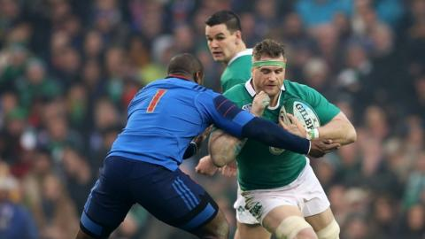 France prop Eddy Ben Arous puts in a tackle on Ireland number eight Jamie Heaslip during a fiercely contested Six Nations game in Dublin