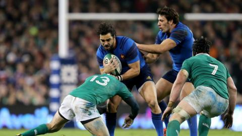 France winger Yoann Huget comes up against Ireland centre Jared Payne as flanker Sean O'Brien prepares to offer support