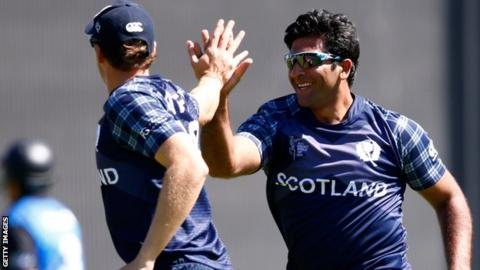 Scotland's Majid Haq celebrates the wicket of Ross Taylor in Dunedin