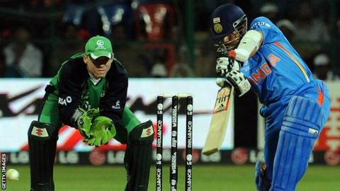 Niall O'Brien and Sachin Tendulkar in action during the 2011 World Cup match between India and Ireland in Bangalore