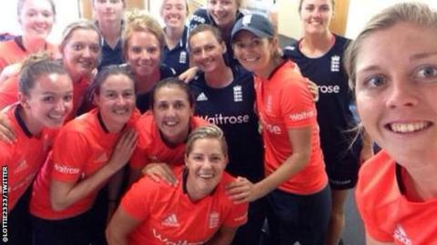 The England team celebrate victory
