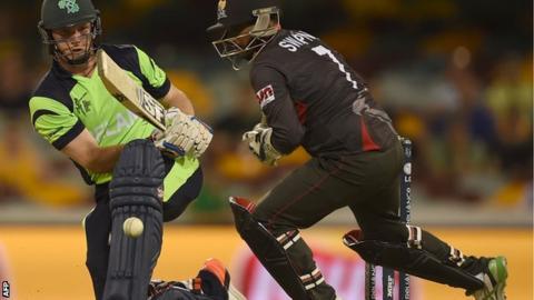 Gary Wilson gets the ball past UAE wicketkeeper Swapnil Patil