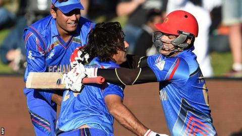 Afghanistan players celebrate their dramatic win against Scotland in Dunedin