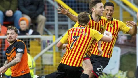 Stephen O'Donnell celebrates after netting the opener for Partick Thistle at Tannadice