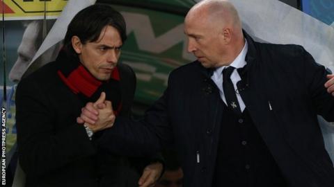 Milan's head coach Filippo Inzaghi (L) greets Chievo's head coach Rolando Maran