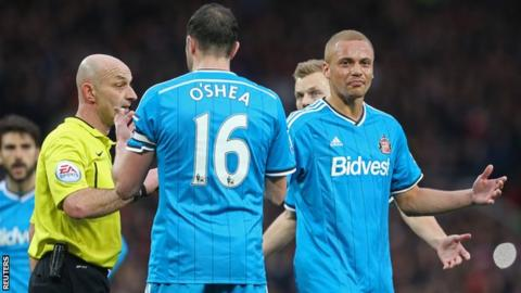 Sunderland defender Wes Brown (right) shows his dismay at being sent off by referee Roger East
