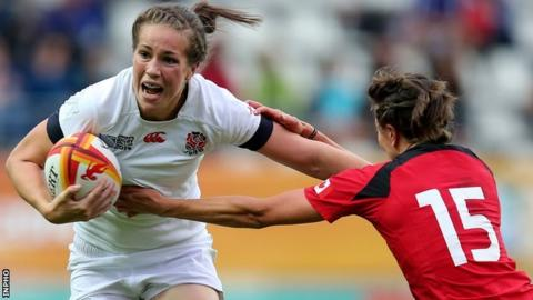 England's Emily Scarratt is tackled by Julianne Zussman of Canada