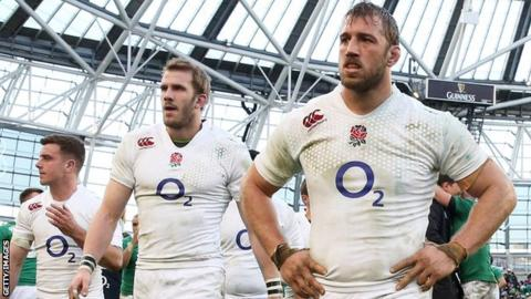 (From right to left) England captain Chris Robshaw, Tom Croft and George Ford walk off looking dejected after England's defeat in Dublin