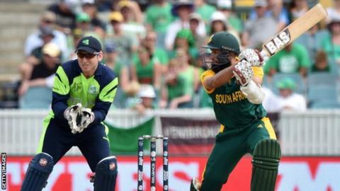 Hashim Amla after hitting a cut shot with Ireland wicket-keeper Gary Wilson looking on