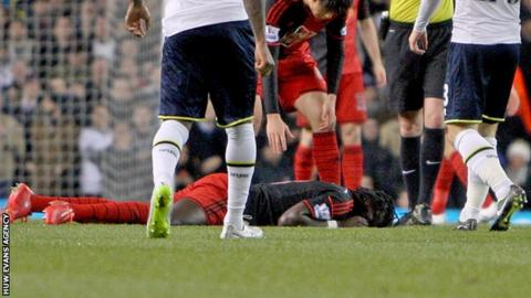 Swansea striker Bafetimbi Gomis was conscious and speaking as he was carried off at White Hart Lane