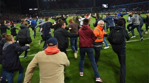 Fans surge past a steward at Villa Park