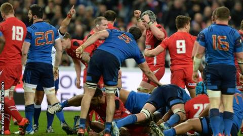 The Wales players celebrate after beating France in Paris