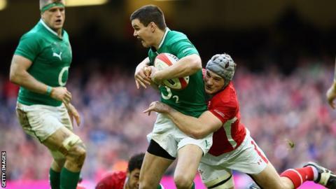 Jonathan Sexton is tackled by Jonathan Davies