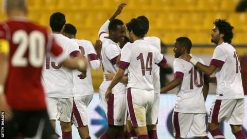 Qatar's national football team celebrate a goal
