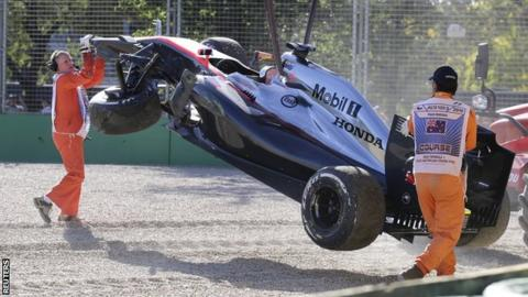 "Danish driver Kevin Magnussen""s McLaren is removed from the circuit after crashing into a tire wall during the second practice session for the Australian Formula One Grand Prix at Albert Park in Melbourne"